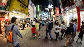 Time Lapse - Busy Shinjuku Entertainment / Shopping District at Night - Tokyo Japan stock footage