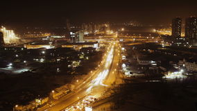Time lapse of busy traffic at night, the light trails of city traffic stock video footage