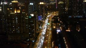 Time lapse busy urban traffic jam at night,urban morden building background. Freeway busy city rush hour heavy traffic jam highway Shanghai at night,china,time stock video footage