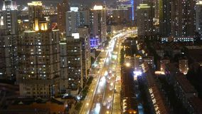 Time lapse busy urban traffic with streaking lights trail at night. Freeway busy city rush hour heavy traffic jam highway Shanghai at night,the light trails of stock footage