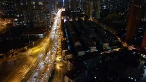 Time lapse busy urban traffic with streaking lights trail at night,shanghai. Freeway busy city rush hour heavy traffic jam highway Shanghai at night,the light stock footage