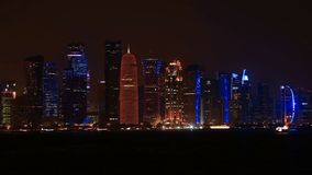 Doha skyscrapers at night. Time lapse: the capital city of Qatar by night. Doha West Bay skyline in Doha Bay. Modern glassed skyscrapers of Doha in Qatar, Middle stock video footage