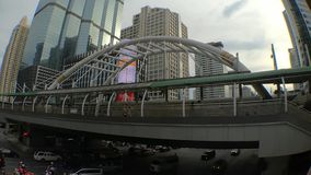 Time-lapse with car of public sky walk and traffic at Chong Nonsi sky train station, Bangkok, Thailand. Time-lapse with car of public sky walk and traffic at stock footage