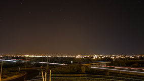 Time lapse with car trails, city skyline and stars. Night Time lapse with busy light trail traffic, city skyline and star trail, static camera stock video