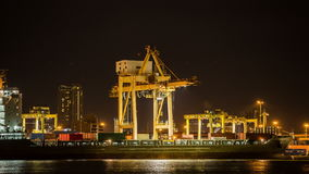 Time lapse Cargo ship. Loading goods at shipping port at night stock footage