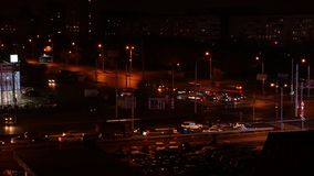 Time lapse of cars driving on crossroad in city at night, aerial view. Beautiful time lapse of cars driving on crossroad in city at night, aerial view. Urban stock video