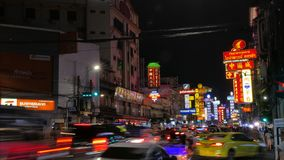 Time lapse of cars and street lights at night at Yaowarat Road Chinatown, Bangkok Thailand stock video footage