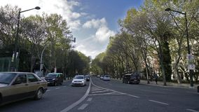 Traffic on the street in Lisbon. Time lapse. chaotic traffic on a street in the center of Lisbon stock footage
