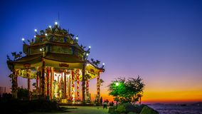 Time lapse of Chinese temple with twilight sky in Sriracha, Chonburi, Thailand. CHONBURI, THAILAND - DECEMBER 8 : Chinese temple with twilight sky on 8 December stock video