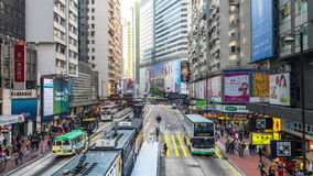Time lapse of city crowded street. hong kong. HONG KONG - JAN 19, 2015: Modern city day traffic at crowded street with skyscrapers, cars and walking people. Time