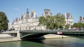 Time lapse of the city hall in Paris. In Paris, a time lapse of the city hall and the Pont d`Arcole parisian bridge. Tourists and Parisians pass over the bridge stock footage