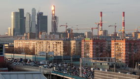 Time lapse city skyline in the evening with heavy traffic Royalty Free Stock Images