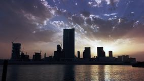 Time lapse of city skyline and work district with modern skyscrapers at sunset - Al Reem Abu Dhabi.  stock video