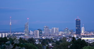 Time-lapse of cityscape at night. Evening scene of the skyscrapers of Vienna, Austria. Day to night transition time-lapse of cityscape stock footage