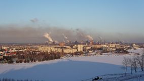 Time lapse cityscape with smoking pipes of metallurgical plant winter. Time lapse cityscape with smoking pipes of metallurgical plant against the blue winter stock video