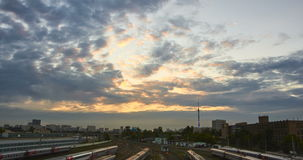 Time lapse cityscape at sunset with the movement of the clouds at background. And many railway tracks at foreground stock video