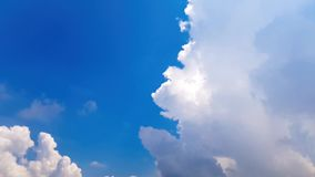 Time lapse moving clouds and blue sky. Time-lapse clip of white fluffy clouds over blue sky on sunny day stock video footage
