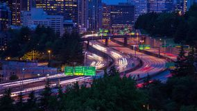 Time Lapse Close Up of Freeway Traffic in Seattle. Time Lapse Close Up shot of Freeway Traffic at Twilight in Seattle, Washington, USA. Highway 5 traffic in long stock footage