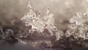 Time lapse close up 4k shot of transparent ice melting into water and in reverse stock footage