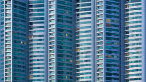 Time lapse close up windows building city day to night stock footage
