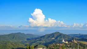 Time-lapse of cloud with rain and rainbow over mountain at Khao Kho, Phetchabun, Thailand stock video