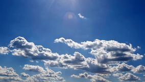 Time lapse clouds above the sun Royalty Free Stock Images