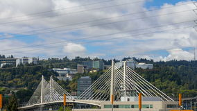Time lapse of clouds and auto traffic with Tilikum Crossing in Portland OR 4k stock video