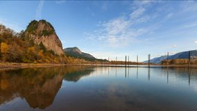 Time Lapse of Clouds and Blue Sky Over Beacon Rock along Columbia River Gorge one Autumn Day stock video footage