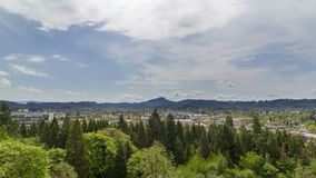 Time lapse of clouds and blue sky over cityscape of Eugene Oregon USA 4k stock footage