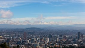 Time lapse of clouds and blue sky over snow covered mt hood and cityscape of Portland OR 4k uhd stock footage