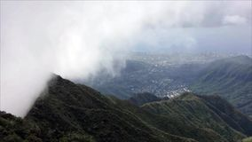 Time lapse of clouds climbing over mountain peak stock video footage