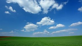 Time lapse clouds at field stock footage