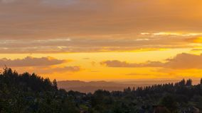 Time lapse of clouds and golden sky over residential suburb homes in Happy Valley Oregon at sunset 4k. UHD 4k Time lapse movie of clouds and golden sky over stock video footage