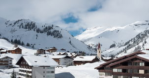 Time lapse of clouds moving over an idyllic mountain village in Austria stock video footage
