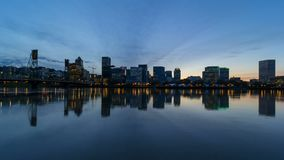 Time lapse of clouds over city of Portland Or with water reflection 4k uhd. Time lapse movie of clouds and sky over downtown city skyline of Portland Or with stock footage