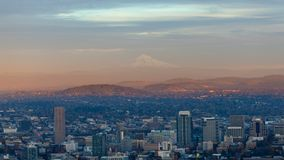 Time lapse of clouds over cityscape with alpenglow on Mt. Hood in Portland Oregon at sunset 4k uhd stock footage