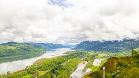 Time lapse of clouds over Columbia River Gorge with i84 auto traffic in Portland OR 4k stock footage