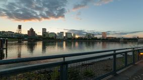 Time lapse of clouds over downtown Portland Or with water reflection at sunset. Time lapse movie of moving clouds and sky over downtown Portland Oregon city stock video