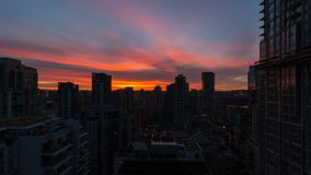 Time lapse of clouds over downtown Vancouver BC from blue hour into sunrise UHD. Ultra high definition time lapse movie of moving clouds over downtown Vancouver stock video footage
