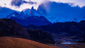 Time lapse of clouds  over Fitz Roy and El Chalten. At twilight stock video
