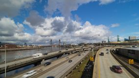 Time lapse of clouds over freeway traffic with cherry blossom trees Portland OR. Ultra high definition 4k time lapse of moving white clouds and blue sky over stock video