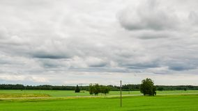Time Lapse clouds over the green fields. View from the hill. stock footage