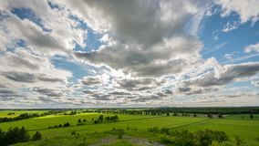 Time Lapse clouds over the green fields. View from the hill. stock video