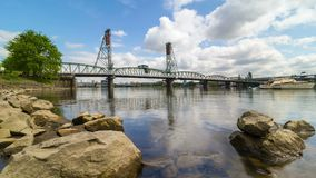 Time lapse of clouds over Hawthorne Bridge along Willamette River in Portland OR 4k. UHD 4k time lapse movie of moving white clouds and blue sky over downtown stock footage