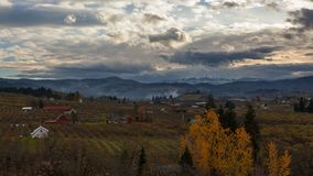 Time Lapse of clouds over Mt Hood and farmlands in Hood River OR Fall season 4k. Ultra High Definition 4k Time Lapse movie of clouds rolling over snow covered Mt stock video footage