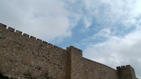 Time Lapse of clouds over the old city wall in Jerusalem, Israel stock video