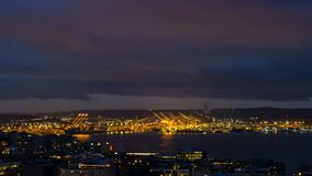 Time lapse of clouds over Port of Seattle along Puget Sound in WA state at dawn stock video footage
