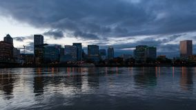 Time lapse of clouds over Portland OR skyline along Willamette River at dusk 4k. Time lapse of stormy clouds and sky over Portland OR downtown skyline along stock footage