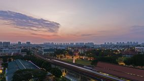 Time lapse of clouds over public MRT and auto traffic in Singapore at sunrise 4k. Ultra high definition 4k time lapse movie of clouds and sky over Eunos housing stock video footage