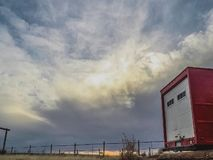 Time lapse of clouds over red trailer